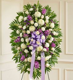 Lavender and white flowers e.g. roses, football mums, snapdragons, stock or carnations.