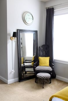 I have always wanted a sitting area like this in my bedroom. Great idea with the mirror.