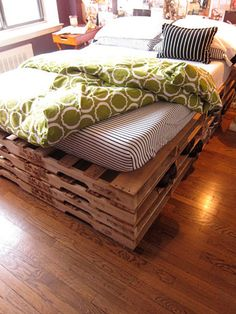 SO getting these! mattress atop pallet skids = cheap bedframe/box spring & shoe storage between the layers!!    I love it.  Only I would probably go only 1 or 2  layers high.    www.50forfifty.com