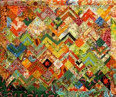 Large prints cut up into simple designs to make non-traditional quilts.