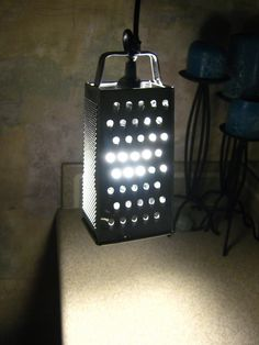 10-minute cheese grater lamp, from the IKEA hackers site. i'm officially in love with this site.