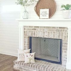 Farmhouse design, Fixer Upper style, wood elements, brick fireplace, light interior