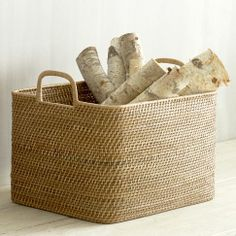 Basket full of wood by the fireplace