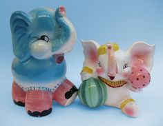 Vintage Circus Elephants. I have some like this in my back yard. The ice cracked them this year. :(