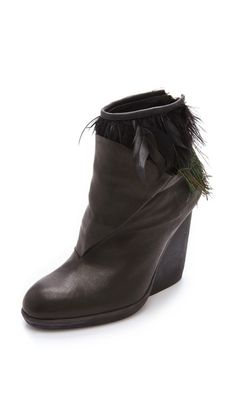 LD Tuttle The Horn Booties.  Probably too edgy for me but I dig the peacock feathers.