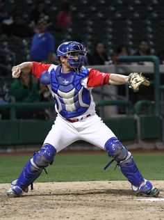 Baseball catcher throwing to second base in dating