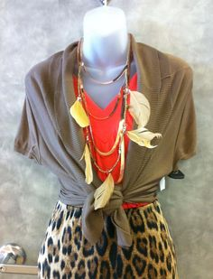 Feathers and copper necklace against popular tangerine tango at Clothes Mentor in North Richland Hills.