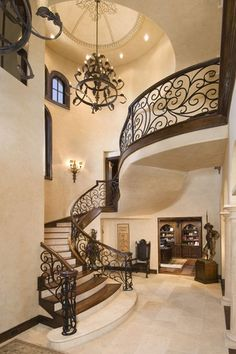 Traditional Staircase with Wall sconce, Arched window, Balcony, Hardwood floors, High ceiling