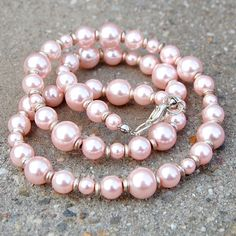 Necklace with light pink glass pearls & silver coloured spacers and findings.