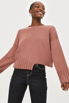The classic jumper gets a modern update with our half hem design. In a subtle but chic rose colour, we're styling this piece with dark denim jeans for a casual look.