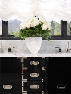 Love the femininity of the flowers juxtaposed with the steam trunk tailoring of the cabinets!