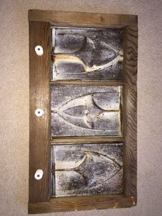 Made from old barn window and tin ceiling tiles with electric fence insulators for pegs. To be used as magnet board or just as a decorative piece. Tile Projects, Metal Projects, Ceiling Tiles Painted, Tin Tiles, Roof Tiles, Glass Room, Tile Crafts, Vintage Tile, Rustic Art
