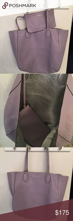 MK Reversible Tote Beautiful lilac with reversible silver lining Tote.  This includes an attached leather pouch perfect for cash, cards and small accessories including maybe even your phone. Bag is in perfect condition. Michael Kors Bags Totes
