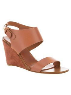 Brown wedge sandal from Sergio Rossi featuring an open toe, a leather sole, a small leather covered wedge heel and a back strap with a adjustable stud fastening.