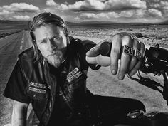 Sons of Anarchy. This is how I picture my MC of my current WIP only with shorter dark hair and a shorter beard.