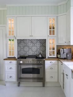 Ikea kitchen with beautiful tiles above the stove