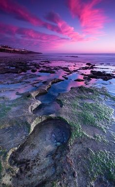 Pink clouds reflected on beautiful blue water...