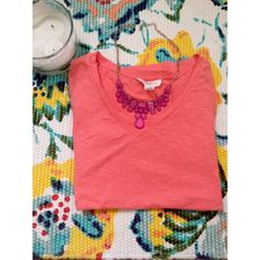 Coral Forever 21 V-neck Good condition basic t-shirt from forever 21. Runs small and has shrunk a little in the laundry. Forever 21 Tops Tees - Short Sleeve