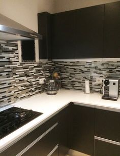 """Eden Mosaic Tile Modern Random Mix Steel - Glass II - """"People love the mosaic, unique in New Caledonia (I think."""" Testimonial by Ariane R. Kitchen Photos, Kitchen Ideas, Kitchen Decor, Kitchen Design, Kitchen Updates, Updated Kitchen, Fireplace Surrounds, Fireplace Design, Tile Installation"""