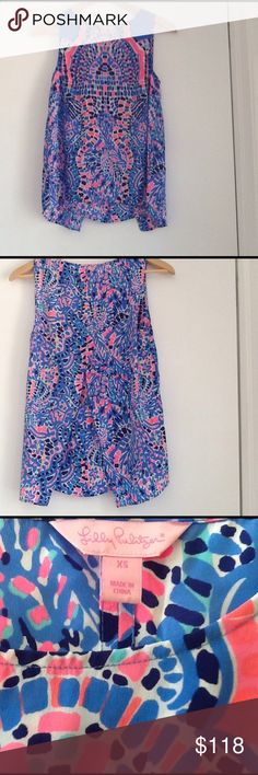 Lilly Pulitzer silk top Lilly Pulitzer, silk tank style top, with small opening in back that has split layers for breezy movement.  Barely worn and no longer available online. Lilly Pulitzer Tops Blouses
