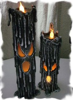 PVC pipe, cut out face, lots of hot glue dripped all over, let dry, paint, and insert flame-less candles.