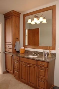Cabinet knobs and pulls matched to bathroom fixtures by Neal's Design Remodel.