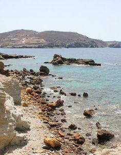 Cliffs meet the rugged coastline on Antiparos in Greece
