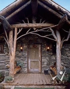 Fabulous rustic front porch wood with gray stone. Great rustic entrance for a cabin at the lake or in the woods