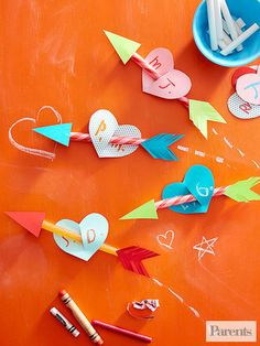 Trace and cut out an arrowhead, a fletching, and a heart for each card (get the template below). Then write on and cut a slit in the heart, slide it over a candy stick, and tape the arrow pieces to each end.