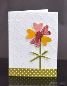 Amazing simple card by Paula Pascual » Scrapbooking With Tubo ... luv the heart petal flower ... ribbon stem and bow ... embossing folder dot trellis ... green polka do band that anchors flower ... happy look ... Sizzix