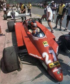 Brasilian Grand Prix, 1982: Gilles Villeneuve in the pits in his Ferrari 126C2, with enough downforce generated by the ground effect venturi there was no need for front wings on the car for the ultra fast Jacarepagua track.