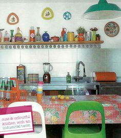 this is adorable! love the different coloured chairs and love the multi coloured vases and etc in the background