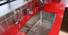 Red countertop stainless sink.   Ruby Reflections : 7450   Caesarstone