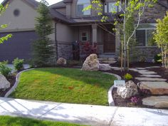 No sidewalk to street, great solution. Large trees placed just right in a small front yard. | Chris Jensen Landscaping in Salt lake city and Utah county