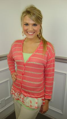 The classic cardigan gets a makeover... It is coral and tan with an ivory ruffle at the hemline. It looks green in the photo, because we layered it over a green cami for a pop of color :) Use this cardigan as outerwear or build an outfit around it!     Fits true to size. Stacy is wearing size sma