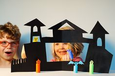 Set a spooky theme with this DIY Haunted House Theater and printable finger puppets!