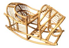 Get the latest in decor styling for your nursery or family room! Unusual vintage rattan bamboo children's rocker. This is like a rocking chair but has handles and a little bucket seat that the child sits in so they won't fall out. This can be used as a special accent piece in a living room, family room, playroom, baby's room, bedroom or sun porch.   This is very sturdy and strong and is for use not just for show. The rattan is in great condition.