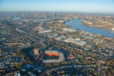 Canary Wharf and London's financial district sit in the background of this aerial shot of Charlton Athletic's The Valley Charlton London, Charlton Athletic Football Club, London Football, Paisley Scotland, Sports Stadium, Football Stadiums, World Cities, Stamford, City Photo