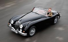 A rare 1950s Jaguar sports car with just 500 miles on the clock is to be sold   after being painstakingly reconstructed from parts packed away in boxes.