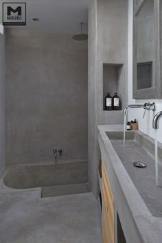 Home Interior Design Concrete Bathroom with Soaking Tub, and built in Vanity, Masculine and Modern.