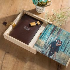 Handcrafted leather album in a beautiful pine wood box created using finest quality pine wood, this wooden box comes with an exclusive all wood printed slide-in wooden cover
