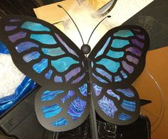 Learn how to build giant butterfly puppets.