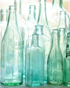 Antique bottles. No. 2, old blue green bottles in morning light with sea glass colors. photo by Lauren.