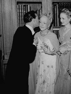 size: Premium Photographic Print: Famed Interior Decorator Lady Mendl Being Kissed by Oliver Messel at the British Embassy by William Vandivert : Artists Elsie De Wolfe, Villa, 20th Century Fashion, Looking Stunning, Still Image, Interior Decorating, Couple Photos, Lady, British
