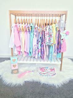 Mini clothes rack- Kmart Bamboo towel rail + wooden hangers + fur rug