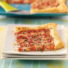 Tomato Tart with Three Cheeses Recipe -This quick and easy recipe will delight any pizza lovers in your home. You will be surprised at how fast it comes together.—Taste of Home Cooking School, Greendale, Wisconsin