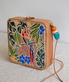 Inspired by nature, we create uniquely spirited wooden accessories such as wood bag, wood backpack, wood purse, wood clutch and wood wallet since Wooden Purse, Ceramic Beads, Ceramic Art, Vintage Purses, Cute Bags, Glazed Ceramic, Clutch Bag, Purses And Bags, Mosaic