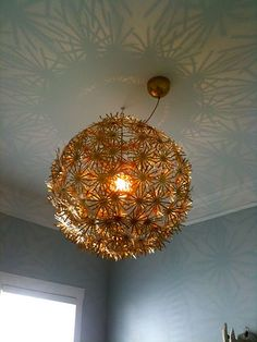 Ikea chandelier that we spray painted gold for the Nursery!