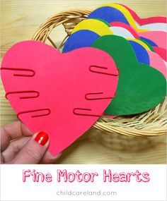 Easy to set up fine-motor center that reinforces color recognition! Hearts cut from colorful paper. Provide colorful paperclips to match. Kiddos slide the paperclips onto the matching hearts. Preschool Fine Motor Skills, Early Learning Activities, Motor Skills Activities, Toddler Activities, Physical Activities, Valentine Theme, Valentine Day Crafts, Preschool Themes, Preschool Activities