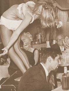 That's Joe Namath sitting at that table in the front, while go-go dancers frug and shimmy on table tops.  I like the way that no one, except for one customer way in the back, is paying any attention to the dancers at all.  Just a normal meal, with a girl dancing  on the table next to you.